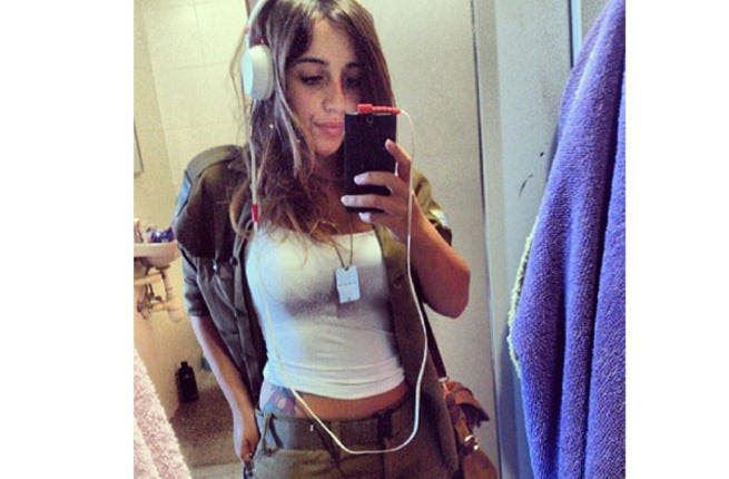Hipster IDF girl doesn't care what you have to say. She's too busy flashing the tat and listening to the national anthem.