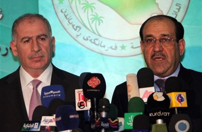 Iraqi Parliament Speaker Osama Al-Nujaifi (L) and Prime Minister Nuri al-Maliki hold a press conference in Baghdad.