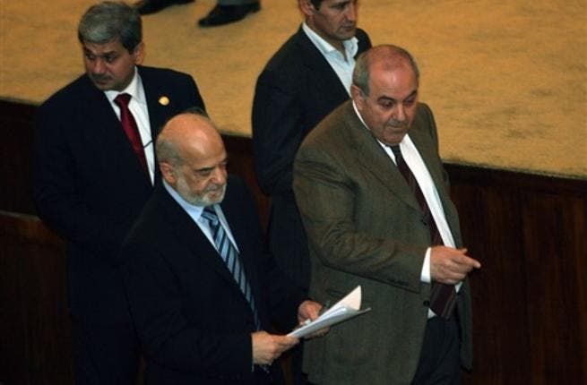 Iraqi former prime minister and now member of Parliament and head of the Iraqiya bloc Iyad Allawi (R) and former Iraqi prime minister Ibrahim al-Jaafari, now member of Parliament and of the National alliance, walk together in parliament.