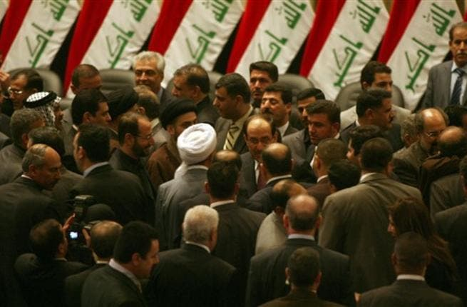 Iraqi Prime Minister Nuri al-Maliki is surrounded by lawmakers in the parliament after giving him a vote of confidence and adopted a 43-point program.
