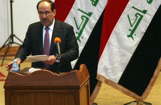 Iraqi Prime Minister Nuri al-Maliki addresses the parliament during a session in which lawmakers unanimously approved the new government which will be headed by the incumbent Shiite premier.