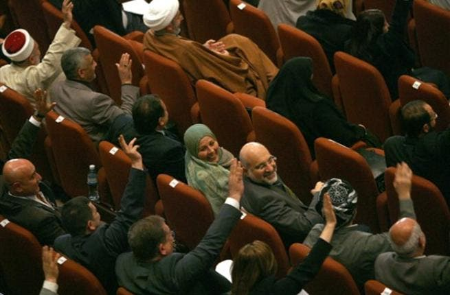 Iraqi MPs vote in parliament in Baghdad as lawmakers gave Prime Minister Nuri al-Maliki's government a vote of confidence and adopted a 43-point program aimed at liberalising the economy and fighting terrorism.