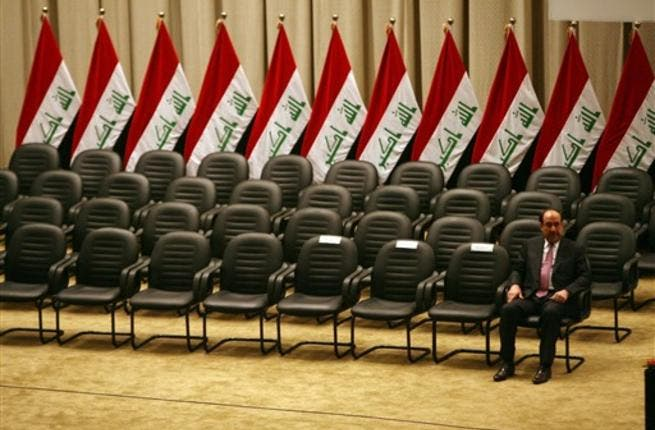 Iraqi Prime Minister Nuri al-Maliki waits for the members of his new cabinet to arrive during a parliamentary session in Baghdad in which lawmakers unanimously approved the new government which will be headed by the incumbent Shiite premier.