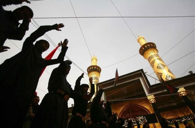 Shiite Muslim men beat their chests in an Ashura ritual in the shrine city of Karbala in central Iraq, as believers prepare to mark the religious event of Ashura in commemoration of ten days of mourning for Imam Hussein, the grandson of Prophet Mohammed who was killed in the Battle of Karbala.