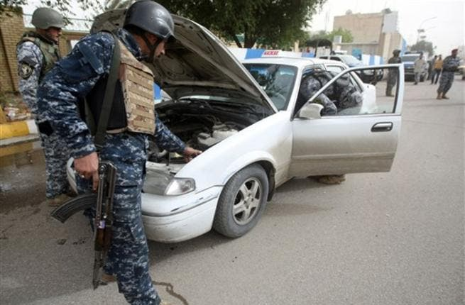 Iraqi troops implement strict security measures on main roads in Baghdad.