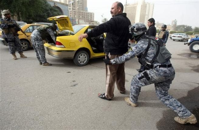 Iraqi troops implement strict security measures on main roads in Baghdad,as Shiite Muslims prepare to mark the religious event of Ashura on December 17 at the end of ten days of mourning for in commemoration of the 7th century killing of Imam Hussein.