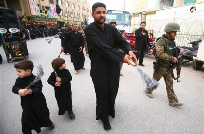 Iraqi soldiers protect a Shiite Muslim Ashura procession in the shrine city of Karbala in central Iraq.