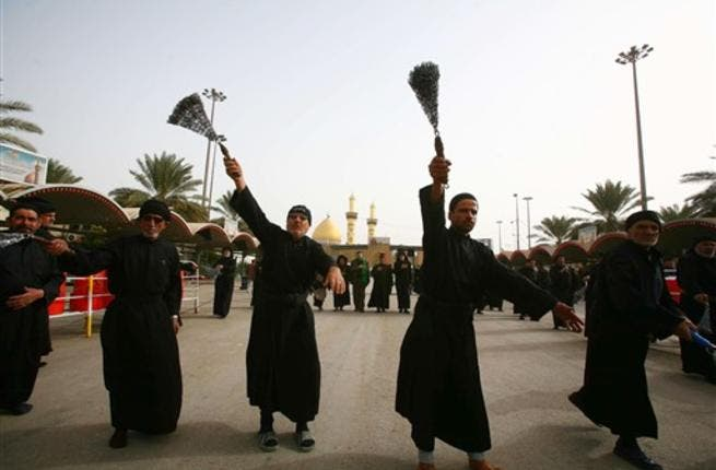 Shiite Muslim men flagellate themselves with chains in an Ashura ritual in the shrine city of Karbala in central Iraq, as believers prepare to mark the religious event of Ashura on December 17 in commemoration of ten days of mourning for Imam Hussein.
