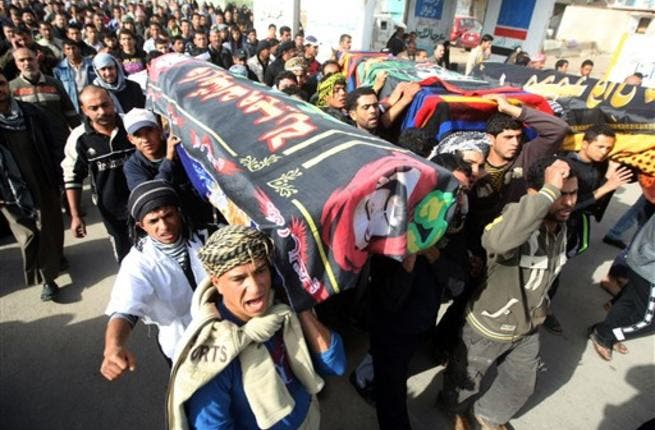 Iraqi Shiite Muslims carry the coffins, of people killed in a bomb blast that targeted a convoy of pilgrims in the Ghazaliyah district of Baghdad as Shiite Muslims prepare to mark the religious event of Ashura.
