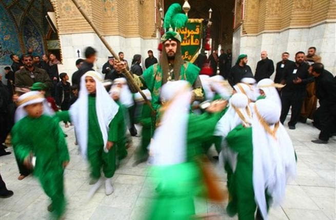 Shiite Muslims act the story of Imam Hussein in an Ashura ritual in the shrine city of Karbala as believers prepare to mark the religious event of Ashura in commemoration of ten days of mourning for Imam Hussein, the grandson of Prophet Mohammed who was killed in the Battle of Karbala.