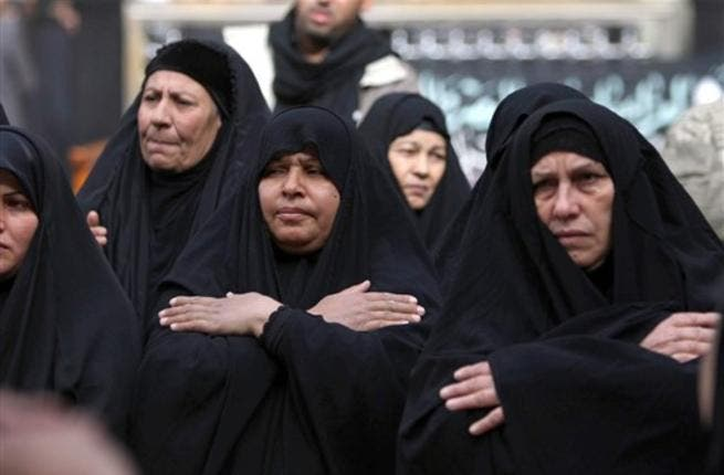 Shiite Muslim shiite women beat their chests in an Ashura ritual in the shrine city of Karbala, as believers prepare to mark the religious event of Ashura 17 in commemoration of ten days of mourning for Imam Hussein, the grandson of Prophet Mohammed who was killed in the Battle of Karbala.