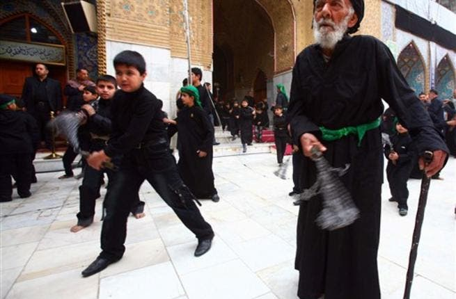 Shiite Muslim men and lads flagellate themselves with chains in an Ashura ritual in the shrine city of Karbala in central Iraq.
