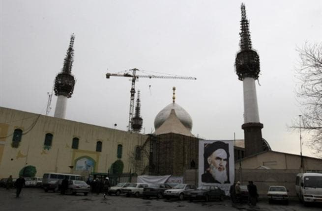 A poster of Ayatollah Ruhollah Khomeini, the late founder of the Islamic republic, adorns the Khomeini's mausoleum as people attend a ceremony marking the 32nd anniversary of his return from exile.