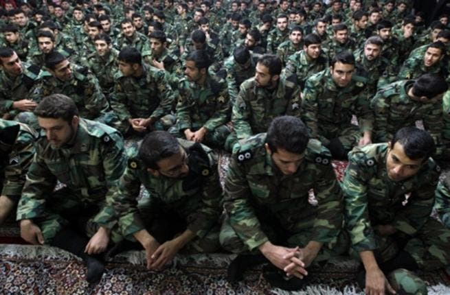 Iranian soldiers sit during the ceremony.