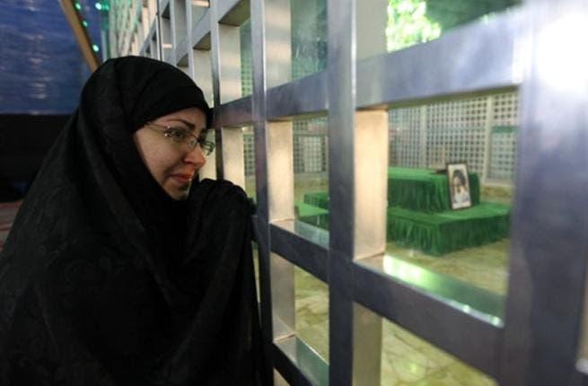 An Iranian woman visit the shrine of Ayatollah Ruhollah Khomeini, the late founder of the Islamic republic.