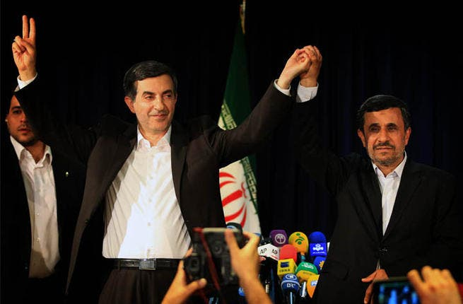 Iran President Mahmoud Ahmadinejad poses with close aide Esfandiar Rahim Mashaie after registering as a candidate in the presidential elections (AFP)