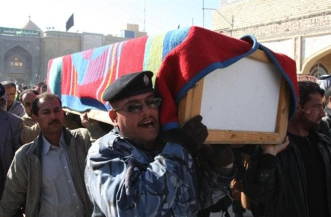 Iraqi mourners carry the coffin of a victim of a spate of blasts that hit across Iraq.