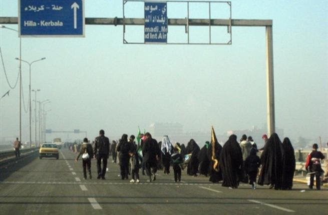 Shiite Muslim pilgrims walk on a main highway linking Baghdad to the central shrine city of Karbala, 120 kms south of the capital, on their way to attend the upcoming Arbaeen religious festival which marks the 40th day after Ashura.