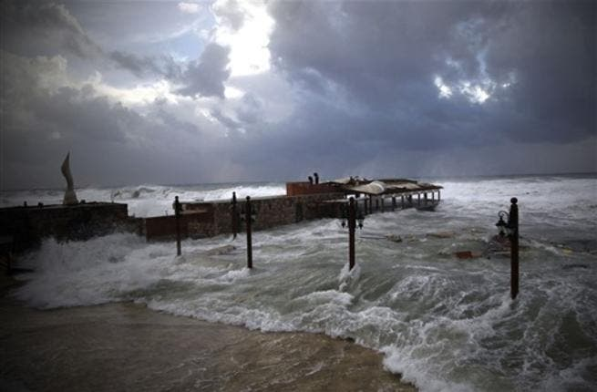 High waves flood a fish restaurant on the Mediterranean coast of the northern Lebanese port of Byblos.