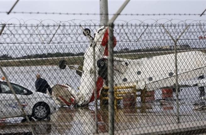 A damaged pilot training plane is pictured at the tarmac of Beirut international airport, as heavy winds topped 100 kilometres (60 miles) an hour.