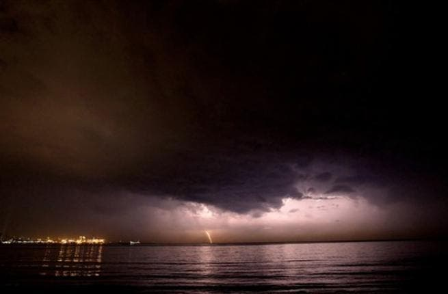 Lebanon, Beirut : Thunder strikes off the shores of Beirut as rain approaches after several months of drought.