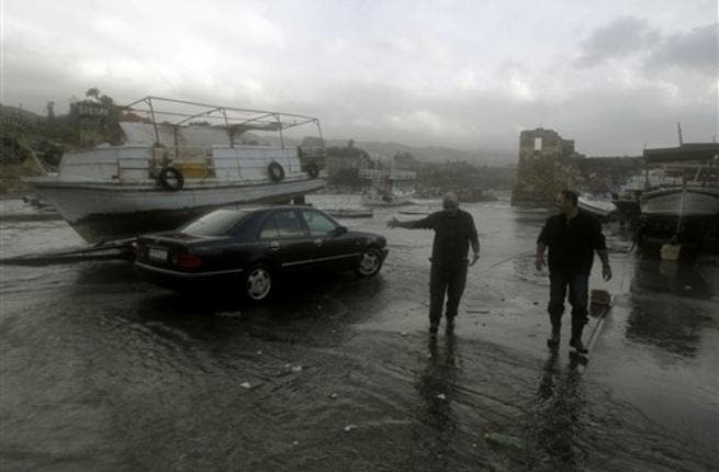 Lebanese fishermen check their boats in the ancient northern port of Byblos.