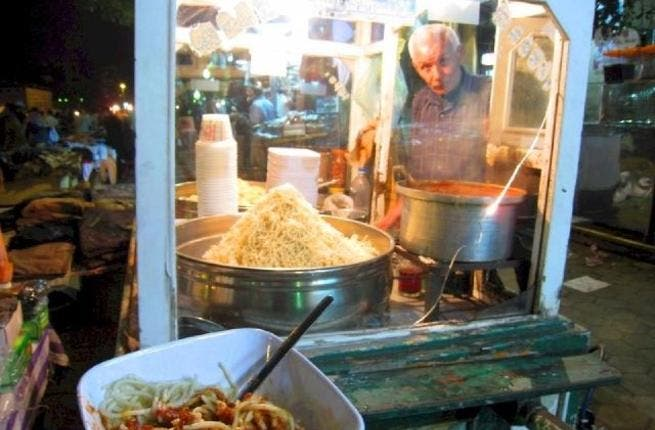 Staying with Egypt, presenting the 'Koshari man': This guy sells a popular traditional Egyptian dish that comes streetside food, from stalls, or as a more fancy affair in a restaurant, as the national dish of pride. It is made of the simple vegetarian ingredients rice, lentils, chickpeas & macaroni, with an optional tomato sauce & fried onion.