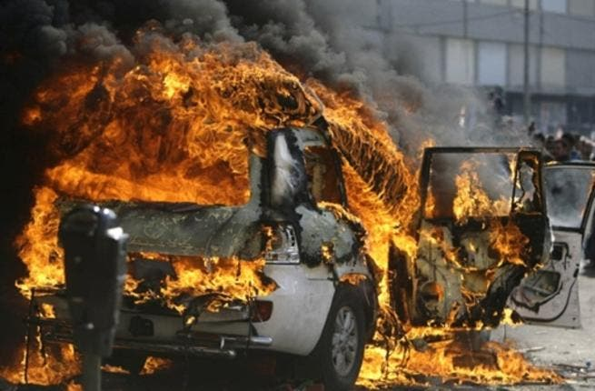 Supporters of the Future Movement torch the vehicle belonging to the Arabic language al-Jazeera satellite television station during a demonstration in support of the caretaker prime minister Saad Hariri in the Sunni bastion coastal city of Tripoli.