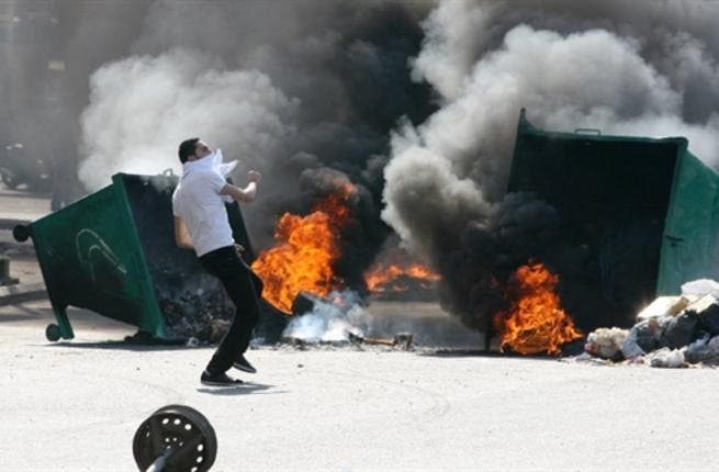 Garbage skips are set on fire.