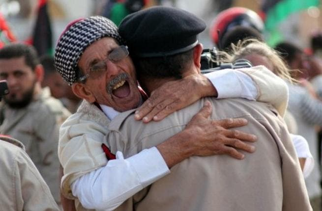 Libyans celebrate following the official day of liberation for the country in the eastern city of Benghazi on October 23, 2011  just days after ousted Colonel Kadhafi was captured and killed.