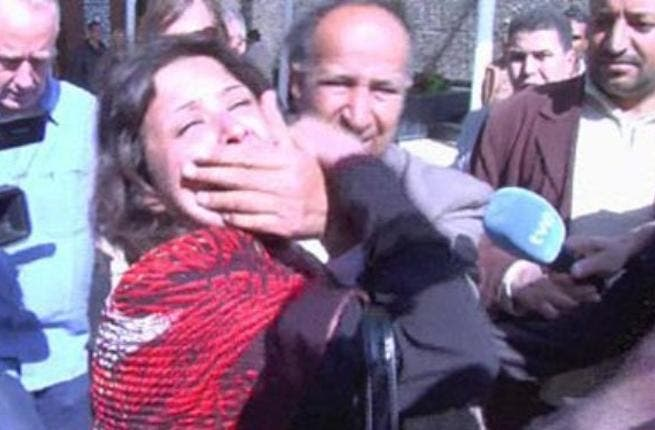 She was manhandled by government minders who attempted to clamp her mouth shut by their hands, But she did not want to go quietly.