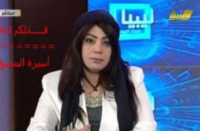 Hala Al-Musrati,female newscaster on Libyan TV attacked Al-Obeidi as drunk, a mental case, a whore! Musrati is the very same one who absurdly deemed 'adoption' of the No-Fly Zone as illegal, since adoption (of children) is illegal according to Islamic doctrine.