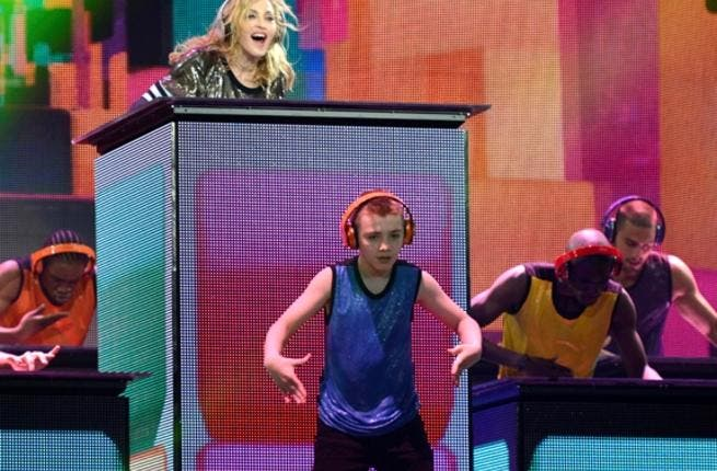Madonna and child: most mothers don't want their kids anywhere near violence and sex but Madge isn't just any old mother. She invited her son to join her on stage in her peace dance with guns.