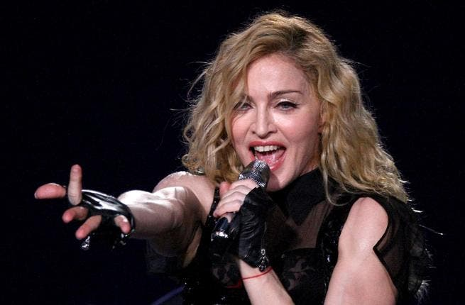 Feeling the heat: Madonna decided to sweat it out in the desert, shunning all offers of AC and sophisticated cooling fan systems for the outdoor venue.
