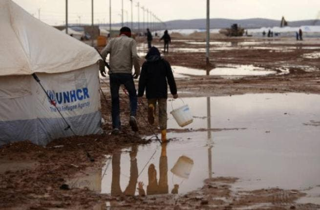 Zaatari riots: Refugees in Jordan's now infamous camp for homeless Syrians attacked aid workers with sticks & stones when  torrential rains flooded their tents. The army were brought in to stem the tide of frustration. Children's play-area tents became temporary accommodation for 900 people - a number set to snowball after Thursday's snowstorm.