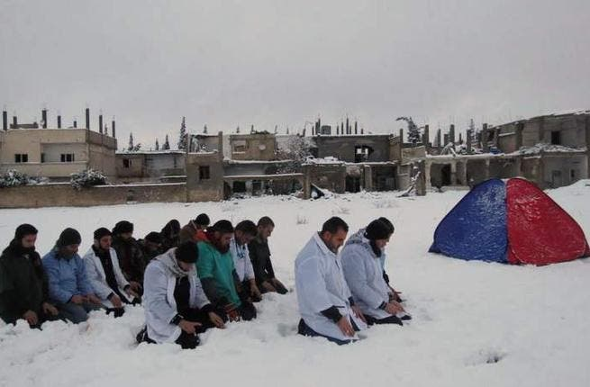 Pictures surfaced of Assad and family making a snowman while beleaguered Syrians froze it out. The picture posted to his 'official' Facebook page was clearly dated but got chins wagging in disgust at the very idea of their president at play. In another snowy place in Syria, medics bunkered down to pray. Mosques across the country turned white.