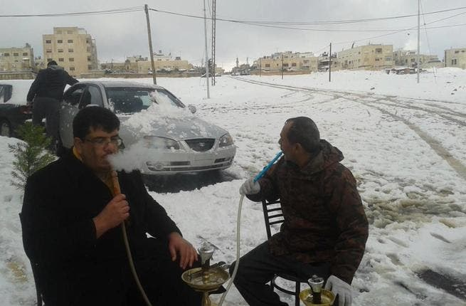 Jordan gets snowed in: Even ahead of the snow, the Kingdom called a state of emergency. Government ministries were closed due to heavy snow, with the army called in to reopen roads in the beleaguered capital - still flooded from torrential rain. But some Ammani residents were taking it all in their stride, having a warming smoke or two.
