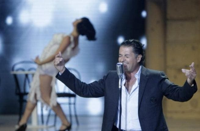 Lebanese singing star Ragheb Alameh performs during the Miss Lebanon 2011 beauty contest.