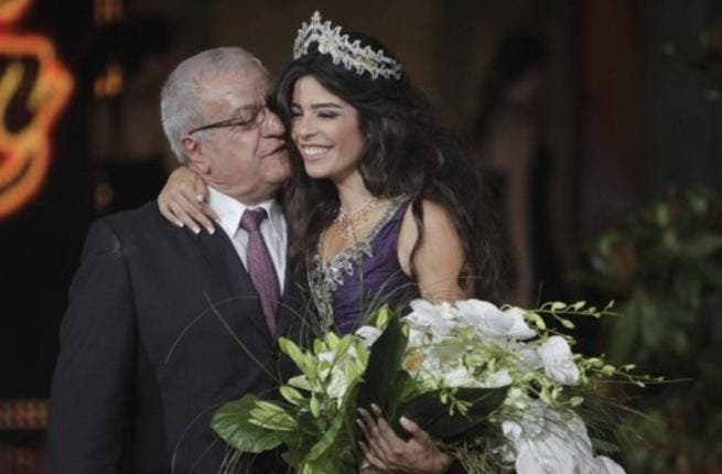 Yara Khoury Mikael is congratulated by her father after winning the Miss Lebanon 2011 beauty contest.