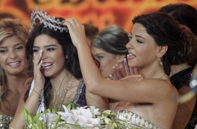 Miss Lebanon 2010 Rahaf Abdallah (R) crowns Yara Khoury Mikael after winning the Miss Lebanon Pageant 2011 beauty contest.
