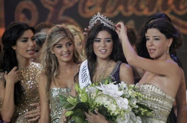 Miss Lebanon 2010 Rahaf Abdallah (R) crowns Yara Khoury Mikael Miss Lebanon 2011 beauty contest.
