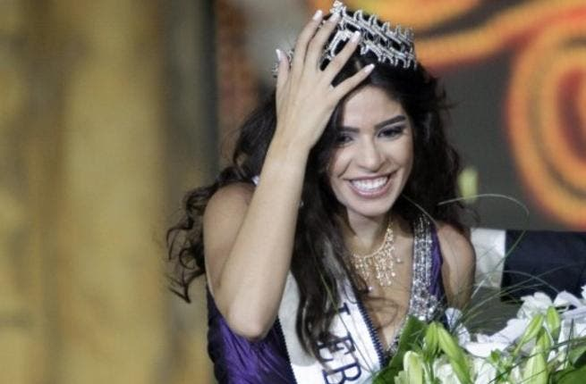 Yara Khoury Mikael is crowned after winning the Miss Lebanon 2011 beauty contest in the commercial center of downtown Beirut.