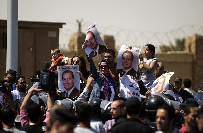 As with the last trial, revolutionaries gathered outside the courtroom calling for Mubarak's execution. But Saturday's protest was tame in comparison to the one that erupted two years ago. Supporters of the former Egyptian leader gathered with posters and even life-size models of the imprisoned president.