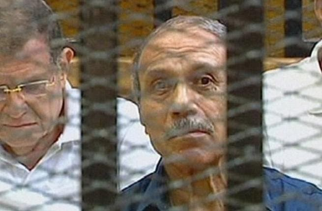 Egyptian former interior minister Habib al-Adly sits in a holding cell in the Cairo Criminal Court on the outskirt of the capital.