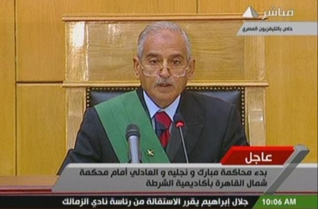 Ahmed Refaat, presiding judge over the court hearing of government officials, including the former Egyptian president and his two sons, opens the first day court session. This judge needs to have presence and to hold court with some authority given the chaos of so many voices vying for attention.