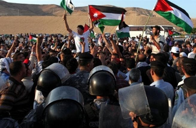 Jordan's East Bank flank- the Jordanian contingent of Palestinian refugees wage their raid on the borders. 6 injured by Jordanian police.