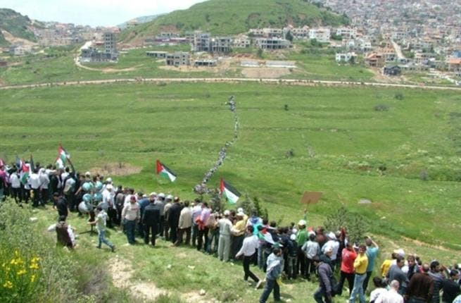 Still Syrian skirmish: a modest army of protesters walking across the fields near town of Majdal Shams in the Israeli annexed Golan Heights on May 15, 2011, as they marched towards the border. Two people killed and dozens wounded  when the Israeli army opened fire at
