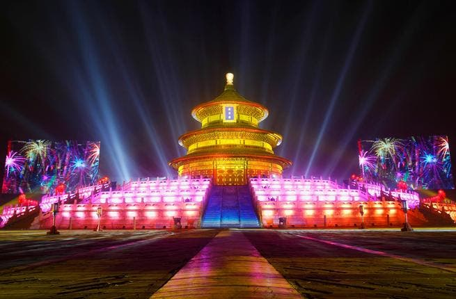The Temple of Heaven (The Qi Nian Temple) is illuminated as Beijing celebrates the New Year's Eve at the Temple of Heaven Park in Beijing, China.