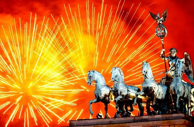 Fireworks explode over the Quadriga statue atop the Brandenburg Gate on New Year's Eve in Berlin, Germany. According to the media, up to one million people celebrate the country's biggest New Year's Eve Party.