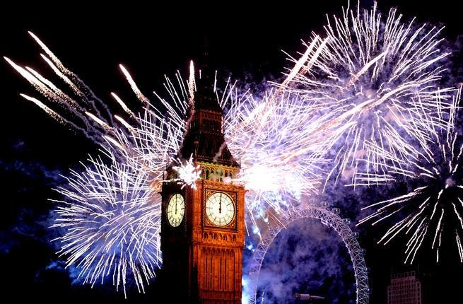 Fireworks light up the London skyline and Big Ben just after midnight in London, England. Thousands of people lined the banks of the River Thames in central London to see in the New Year with a spectacular fireworks display.
